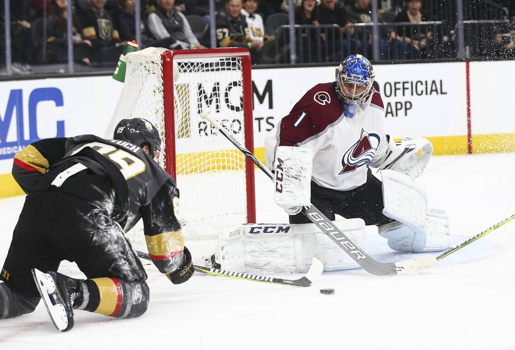 Golden Knights right wing Alex Tuch (89) tries to score against Colorado Avalanche goaltender Semyon Varlamov (1) during the third period of an NHL hockey game at T-Mobile Arena in Las Vegas on Mo ...