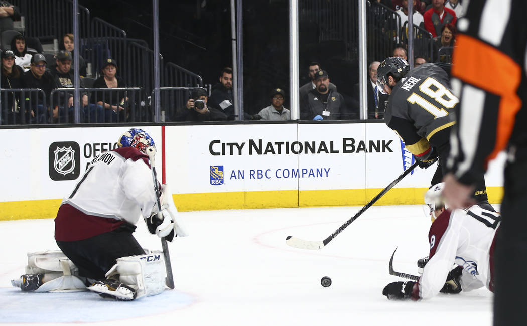 Golden Knights left wing James Neal (18) attempts to score against Colorado Avalanche goaltender Semyon Varlamov (1) during the third period of an NHL hockey game at T-Mobile Arena in Las Vegas on ...