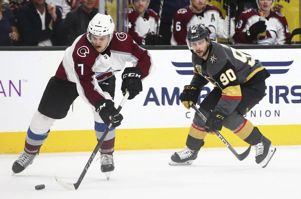 Colorado Avalanche defenseman Mark Alt (7) controls the puck as Golden Knights left wing Tomas Tatar (90) looks on during the third period of an NHL hockey game at T-Mobile Arena in Las Vegas on M ...
