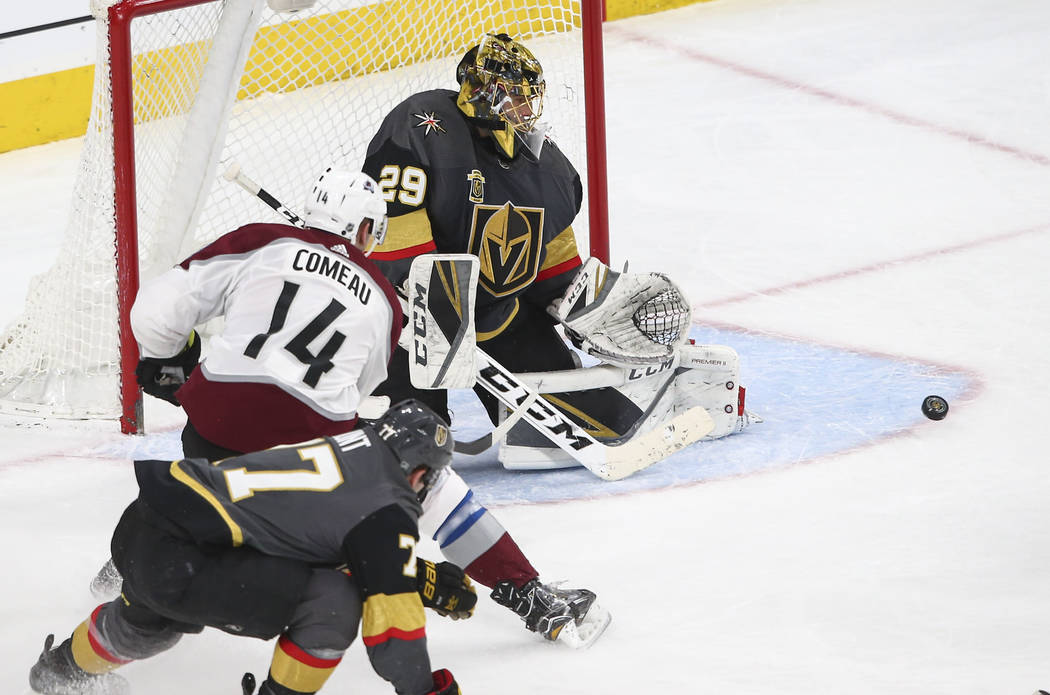 Golden Knights goaltender Marc-Andre Fleury (29) defends the goal as Colorado Avalanche left wing Blake Comeau (14) looks on during the second period of an NHL hockey game at T-Mobile Arena in Las ...