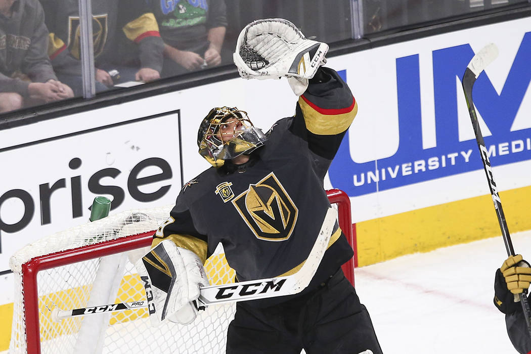 Golden Knights goaltender Marc-Andre Fleury (29) jumps up to catch the puck while playing the Colorado Avalanche during the second period of an NHL hockey game at T-Mobile Arena in Las Vegas on Mo ...