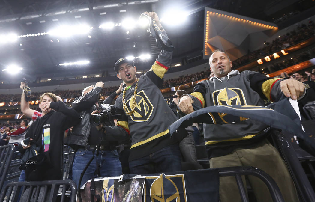 Golden Knights fans celebrate a goal by center William Karlsson (71) against the Colorado Avalanche in the final moments of the third period of an NHL hockey game at T-Mobile Arena in Las Vegas on ...