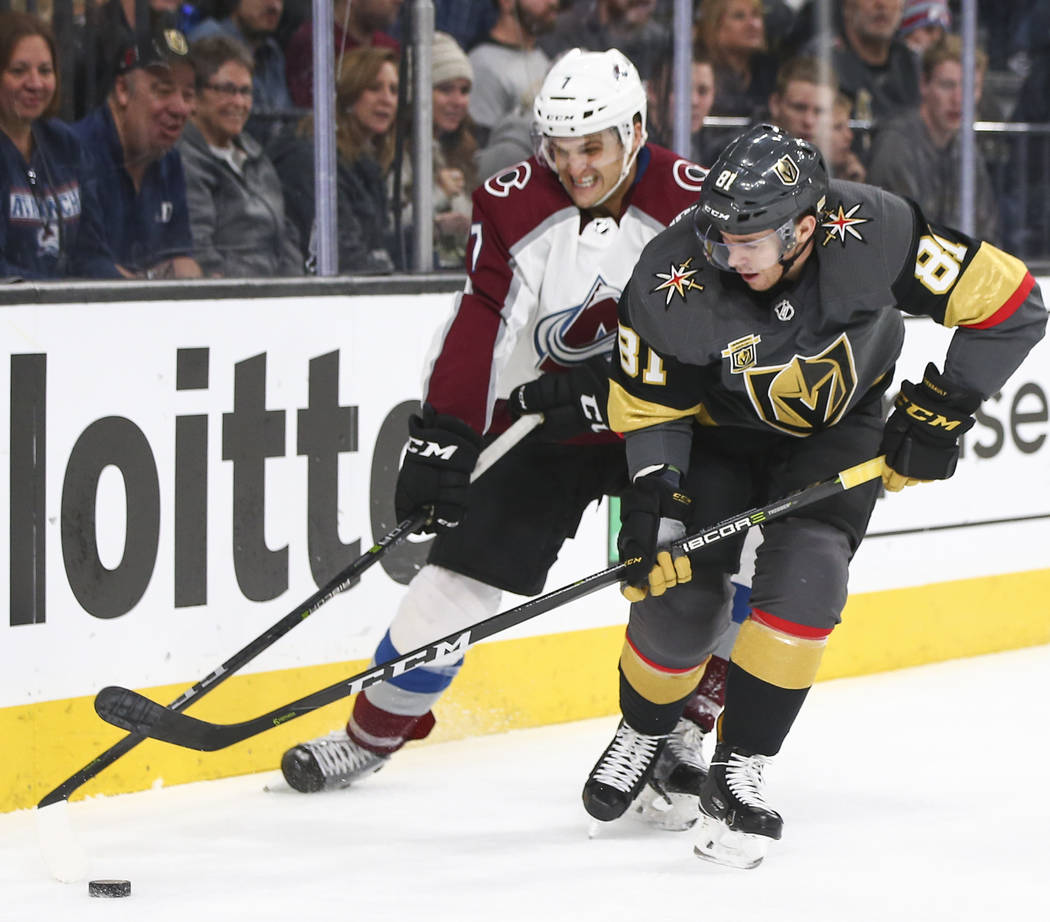 Golden Knights center Jonathan Marchessault (81) controls the puck as Colorado Avalanche defenseman Mark Alt (7) defends during the third period of an NHL hockey game at T-Mobile Arena in Las Vega ...