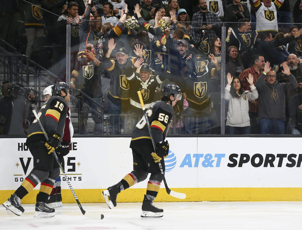 Golden Knights players celebrate a goal by Golden Knights defenseman Shea Theodore, not pictured, during the third period of an NHL hockey game against the Colorado Avalanche at T-Mobile Arena in  ...
