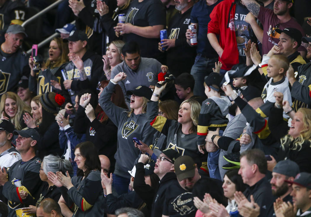 Golden Knights fans celebrate a goal by Golden Knights center Jonathan Marchessault, not pictured, during the second period of an NHL hockey game against the Colorado Avalanche at T-Mobile Arena i ...