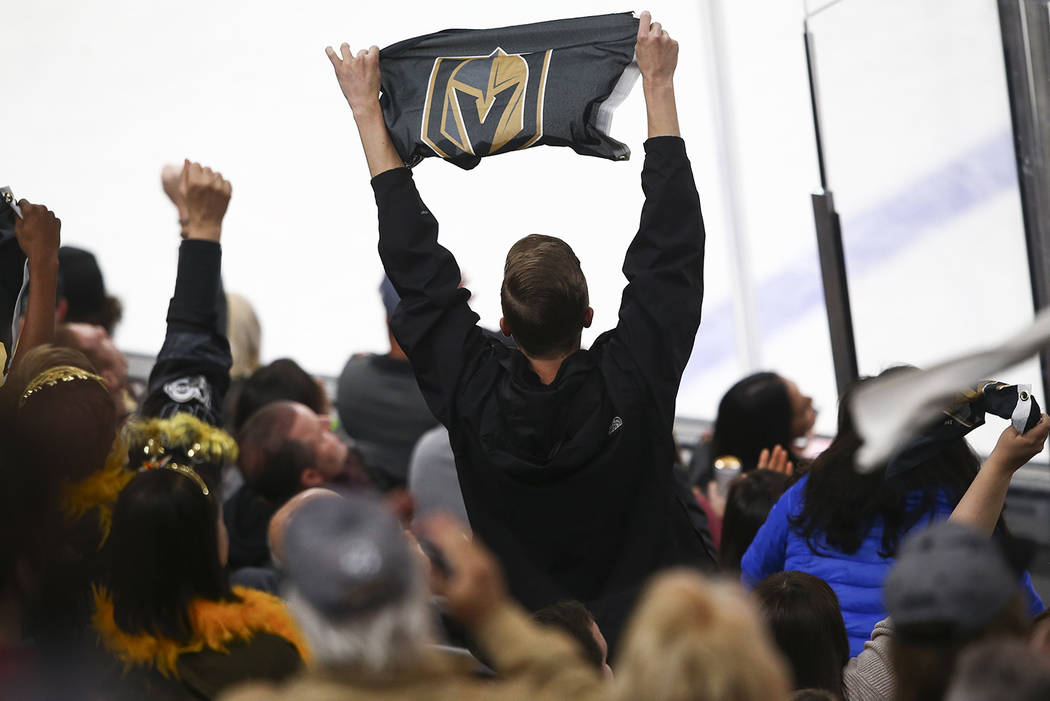 A Golden Knights fan reacts after a series of blocks by goaltender Marc-Andre Fleury (29) during the second period of an NHL hockey game at T-Mobile Arena in Las Vegas on Monday, March 26, 2018. C ...