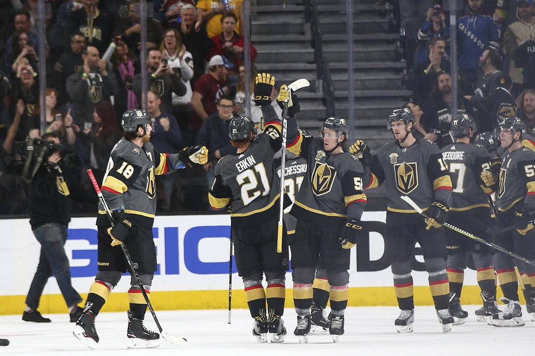 Golden Knights players celebrate their 4-1 win over the Colorado Avalanche in an NHL hockey game at T-Mobile Arena in Las Vegas on Monday, March 26, 2018. Chase Stevens Las Vegas Review-Journal @c ...