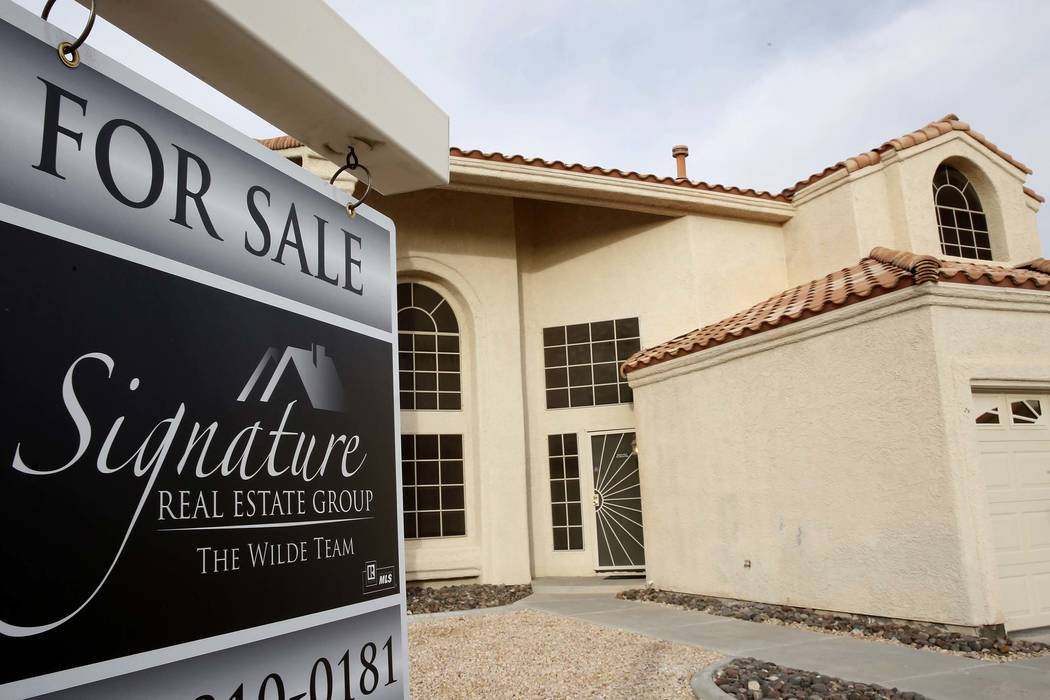 A for sale sign is displayed in front of a home at Gentle Bay Avenue near Windmill Lane Wednesday, Nov. 15, 2017, in Las Vegas. (Bizuayehu Tesfaye/Las Vegas Review-Journal) @bizutesfaye