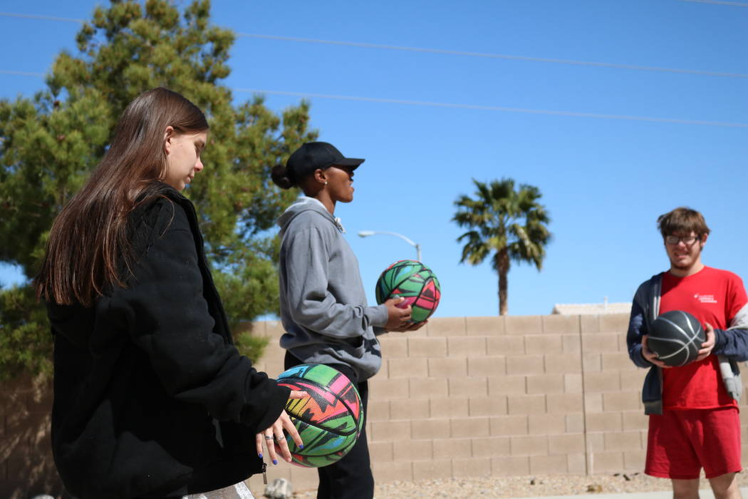 Sequoia Holmes, center, with 16-year-old Taylor Allison, left,  and  16-year-old Nico Felixon at the Nevada Blind Children's Foundation in Henderson, Tuesday, March 27, 2018. Madelyn Reese/Las Veg ...