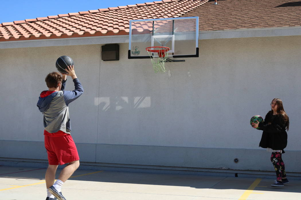 16-year-old Nico Felixon shoots hoops with 17-year-old Carly Lamb at the Nevada Blind Children's Foundation in Henderson, Tuesday, March 27, 2018. Madelyn Reese/Las Vegas Review-Journal