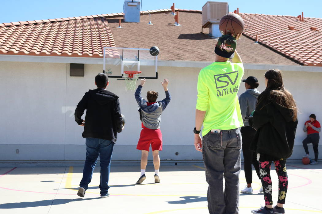 Nico Felixon, Carly Lamb, Taylor Allison and Paul Hernandez shoot hoops with Las Vegas Aces forward/guard Sequoia Holmes at the Nevada Blind Children's Foundation in Henderson, Tuesday, March 27,  ...