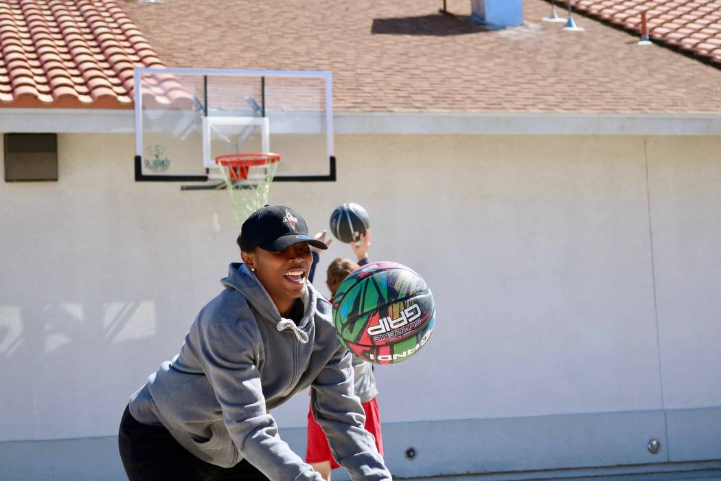 Las Vegas Aces forward/guard Sequoia Holmes attempts a ball trick at the Nevada Blind Children's Foundation in Henderson, Tuesday, March 27, 2018. Madelyn Reese/Las Vegas Review-Journal