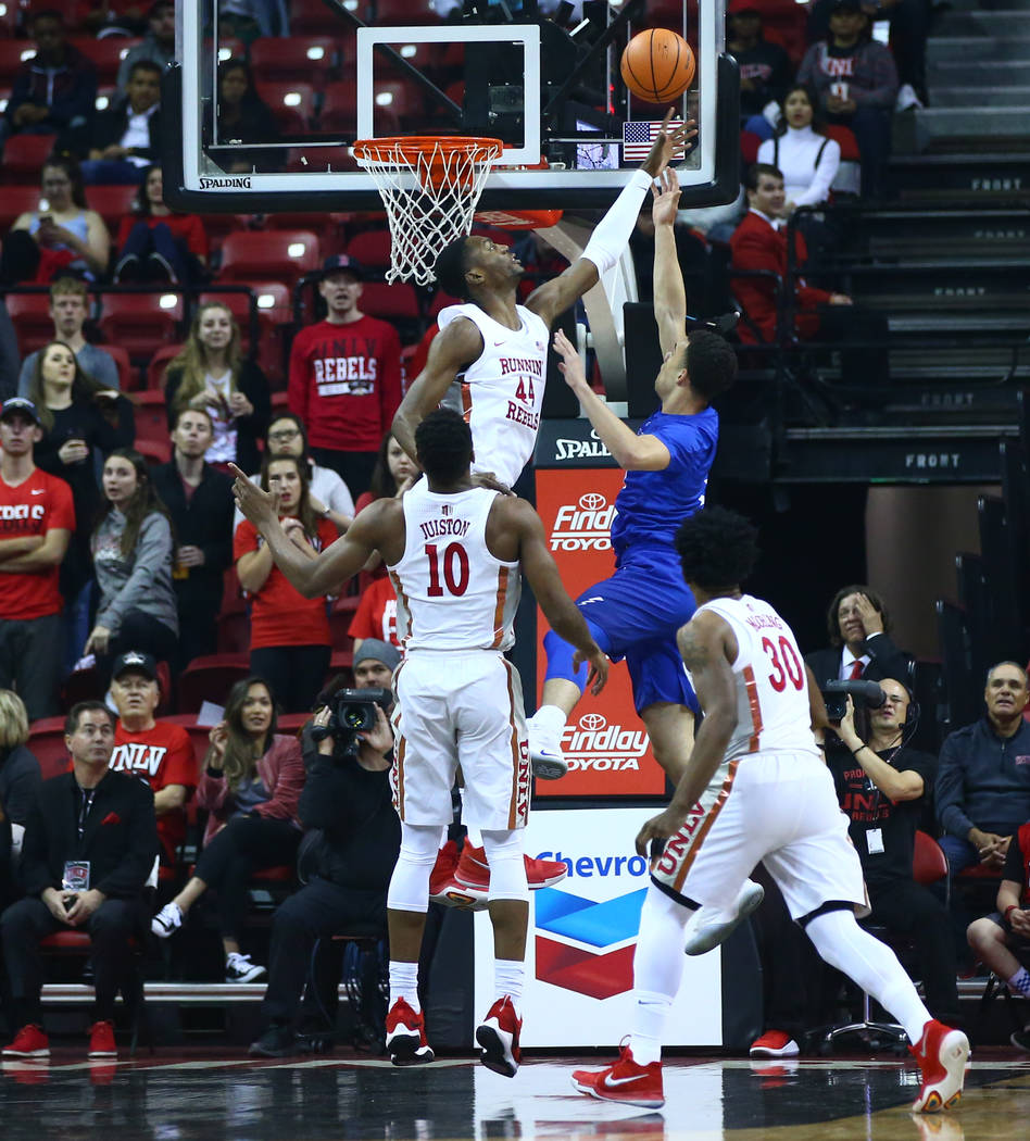UNLV Rebels forward Brandon McCoy (44) blocks a shot from Air Force Falcons guard Sid Tomes (3) during a basketball game at the Thomas & Mack Arena in Las Vegas on Wednesday, Feb. 14, 2018. Ch ...