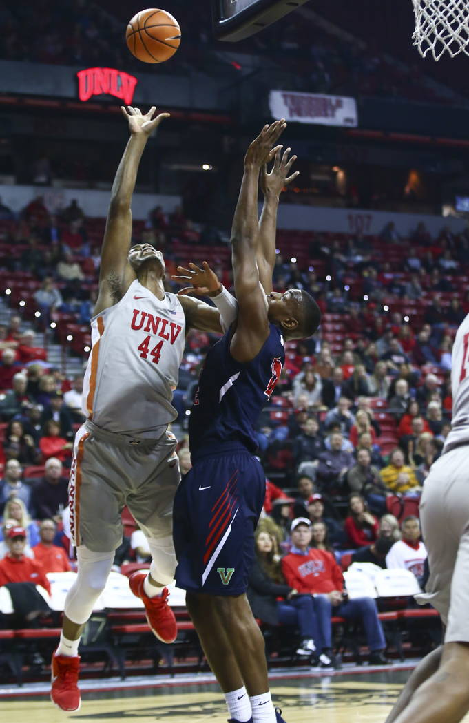 UNLV Rebels forward Brandon McCoy (44) shoots over Fresno State Bulldogs forward Bryson Williams (11) during the first half of a basketball game at the Thomas & Mack Center in Las Vegas on Wed ...