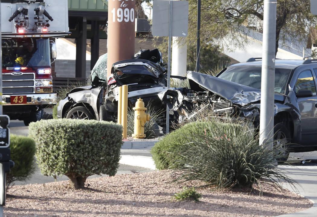 Las Vegas police investigate the fatal crash at Rainbow and Lake Mead boulevards on Monday, March 26, 2018, in Las Vegas. (Bizuayehu Tesfaye/Las Vegas Review-Journal)