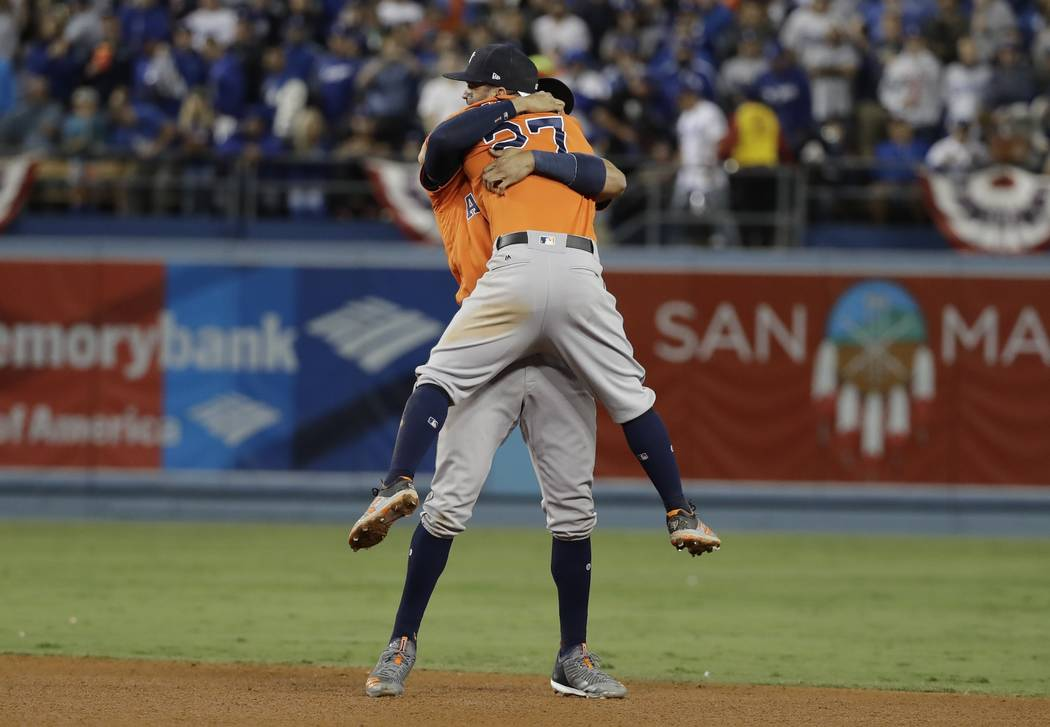 Houston Astros' Jose Altuve and Carlos Correa celebrate after Game 7 of baseball's World Series against the Los Angeles Dodgers Wednesday, Nov. 1, 2017, in Los Angeles. The Astros won 5-1 to win t ...