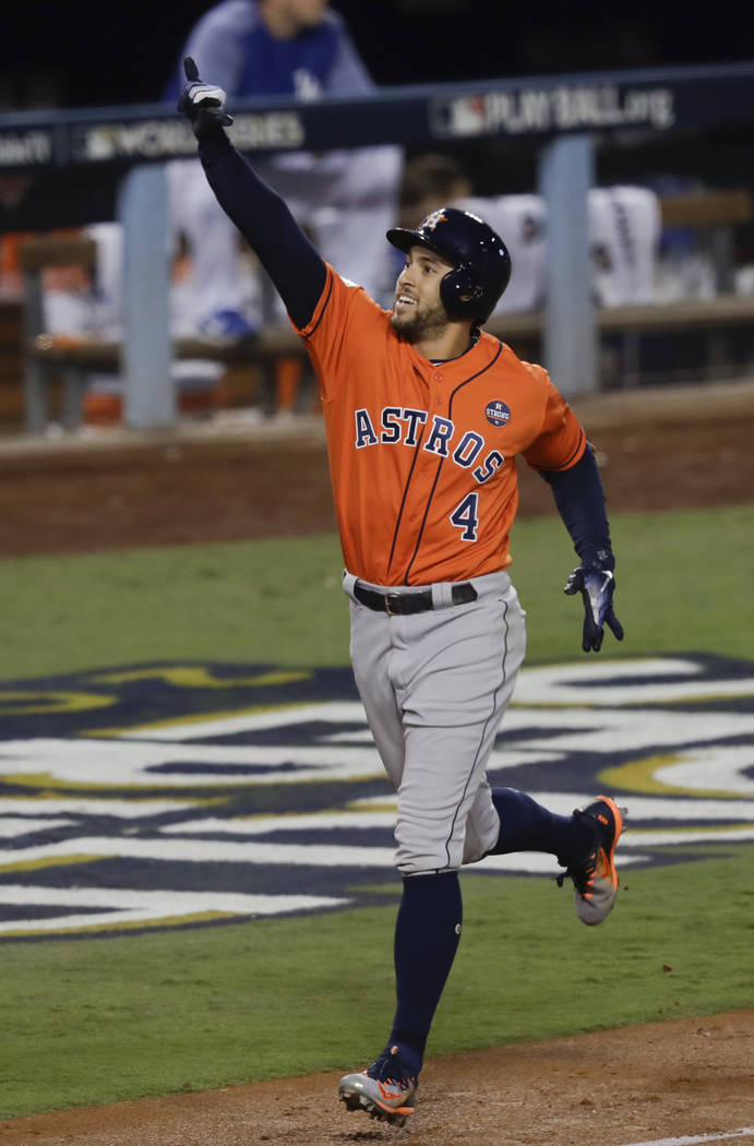 File-This Nov. 1, 2017, file photo shows Houston Astros' George Springer (4) celebrating after his two-run home run against the Los Angeles Dodgers during the second inning of Game 7 of baseball's ...