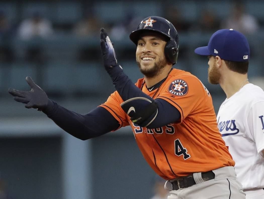 File-This Nov. 1, 2017, file photo shows Houston Astros' George Springer reacting after hitting a double during the first inning of Game 7 of baseball's World Series against the Los Angeles Dodger ...