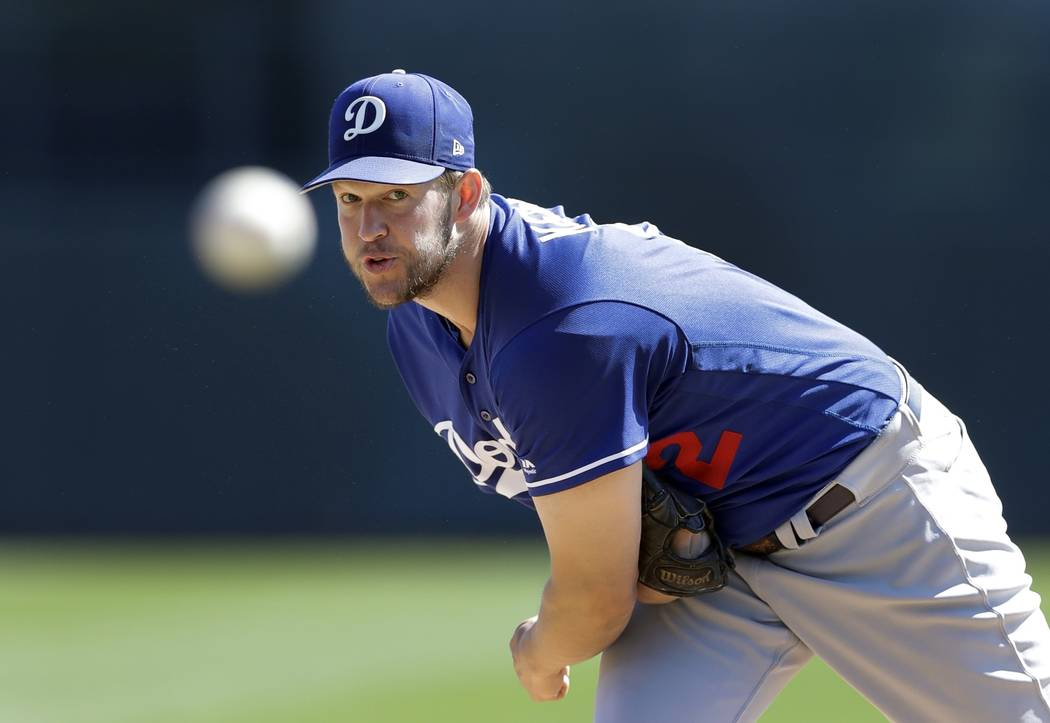 Los Angeles Dodgers starting pitcher Clayton Kershaw throws warmup pitches before the first inning of a spring training baseball game against the Chicago White Sox, Friday, March 2, 2018, in Glend ...