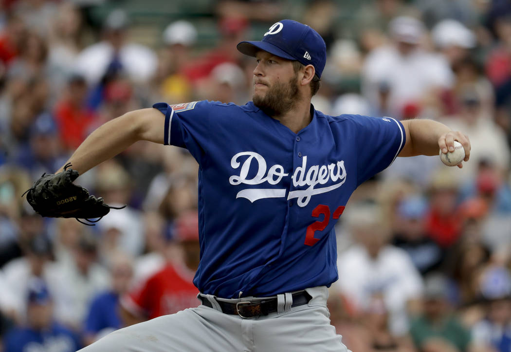 Los Angeles Dodgers starting pitcher Clayton Kershaw throws against the Los Angeles Angels during the first inning of a spring baseball game in Tempe, Ariz., Wednesday, March 7, 2018. (AP Photo/Ch ...