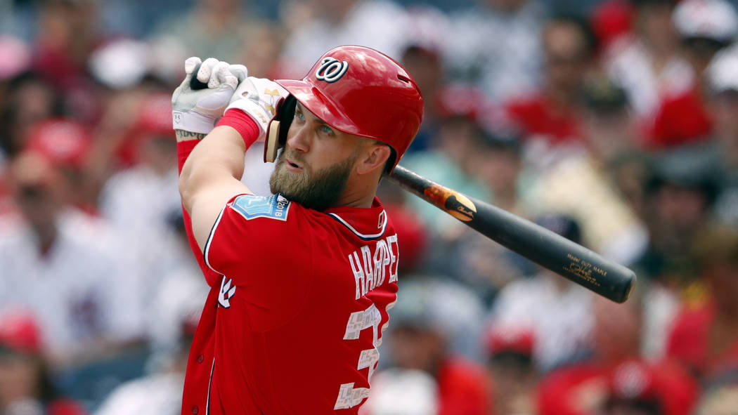 Washington Nationals right fielder Bryce Harper (34) bats during a spring training baseball game against the Miami Marlins Saturday, March 24, 2018, in West Palm Beach, Fla. (AP Photo/John Bazemore)