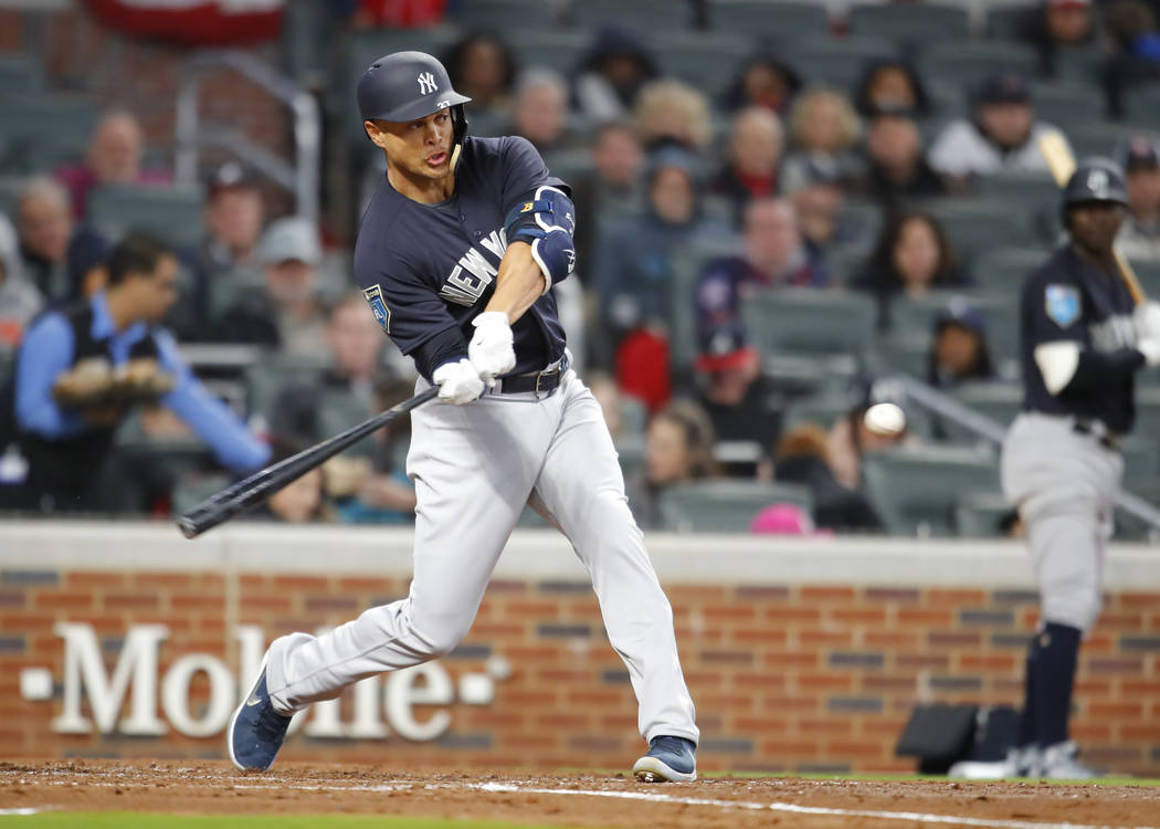 New York Yankees right fielder Giancarlo Stanton hits a two run home run in the third inning of a spring training baseball game against the Atlanta Braves, Monday, March 26, 2018, in Atlanta. (AP  ...