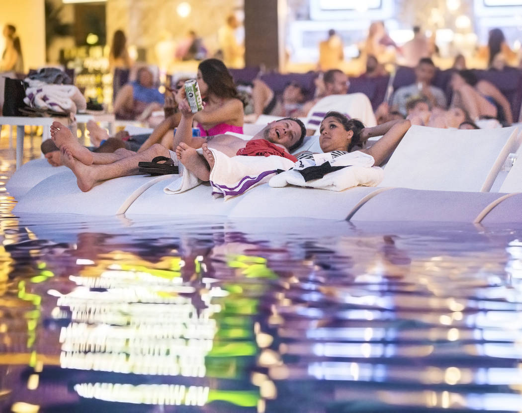 "Poolgoers enjoy a showing of ""Happy Gilmore"" during Dive In Movies at Boulevard Pool at the Cosmopolitan Las Vegas on Monday, June 5, 2017. (Benjamin Hager Las Vegas Review-Journal) @ben ..."