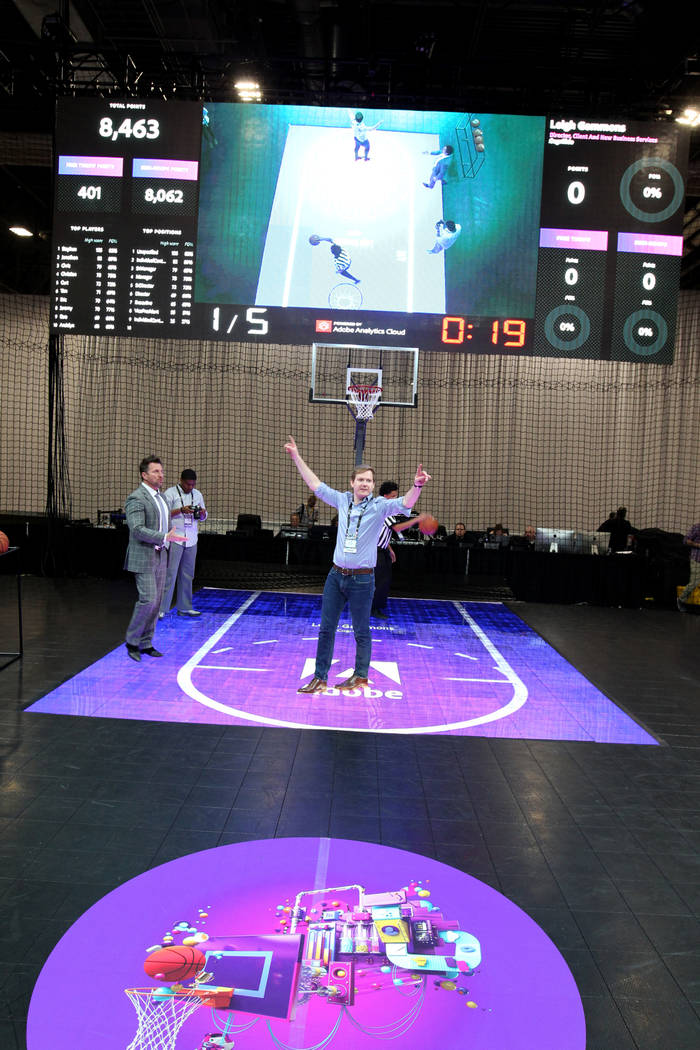 Leigh Grammons of London celebrates making a basket at the Adobe Summit trade show during the March Madness #HackTheBracket application at the Sands Convention Center in Las Vegas Tuesday, March 2 ...