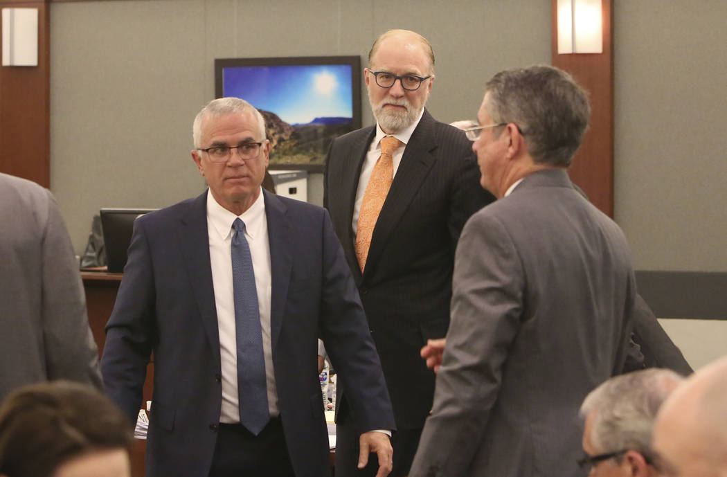 Mark Ferrario, left, a lawyer for Elaine Wynn, and Todd Bice, center, a lawyer for Steve Wynn, appear in court at the Regional Justice Center on Tuesday, March 27, 2018, in Las Vegas. Bizuayehu Te ...