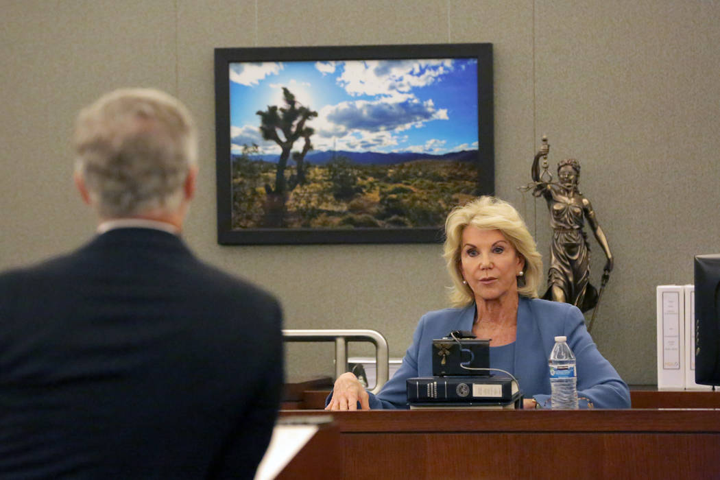 In Clark County District Court at the Regional Justice Center in Las Vegas on Wednesday, March 28, 2018, Elaine Wynn responds to questions from attorney James J. Pisanelli, left, who says Wynn is  ...
