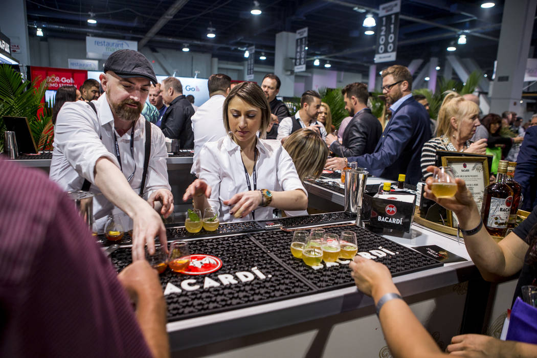 Bacardi bartenders Jimmy McGowan and Jessica Fitzmeyer serve attendees drinks during the Nightclub and Bar Show at the Las Vegas Convention Center on Tuesday, March 27, 2018.  Patrick Connolly Las ...