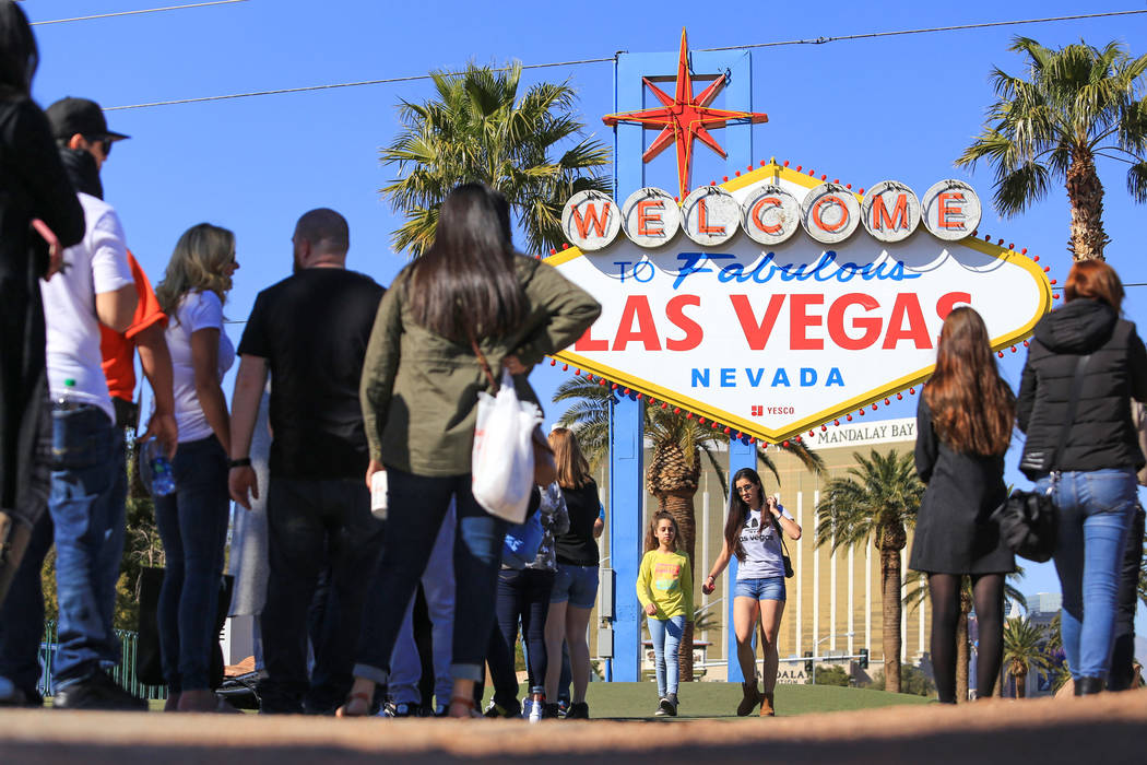 Warm weather greets people as they stand in line to take a photo with the iconic Las Vegas sign on Thursday, March 2, 2017, in Las Vegas. (Brett Le Blanc/Las Vegas Review-Journal) @bleblancphoto
