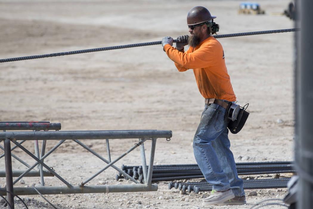 A worker handles steel rod at the future Raiders stadium site in Las Vegas, Tuesday, March 6, 2018. Erik Verduzco Las Vegas Review-Journal @Erik_Verduzco