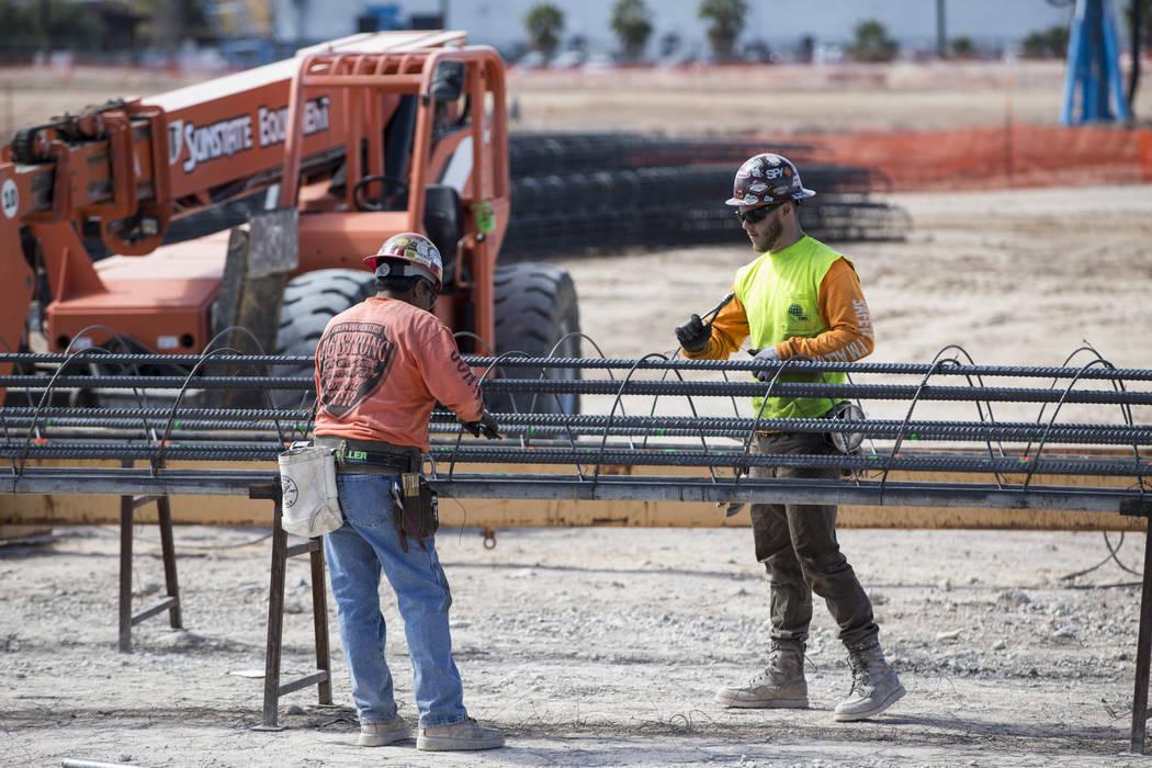 Workers handle steel rods at the future Raiders stadium site in Las Vegas, Tuesday, March 6, 2018. Erik Verduzco Las Vegas Review-Journal @Erik_Verduzco