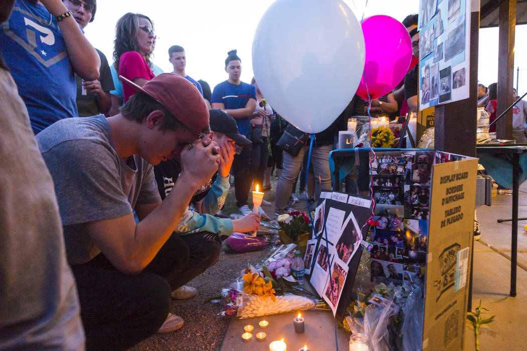 "Brennan Mecke, left, mourns the loss of his best friend, Albert ""A.J."" Rossi, during a candlelight vigil at Knickerbocker Park in Las Vegas Friday, March 30, 2018. Albert ""A.J.&quot ..."
