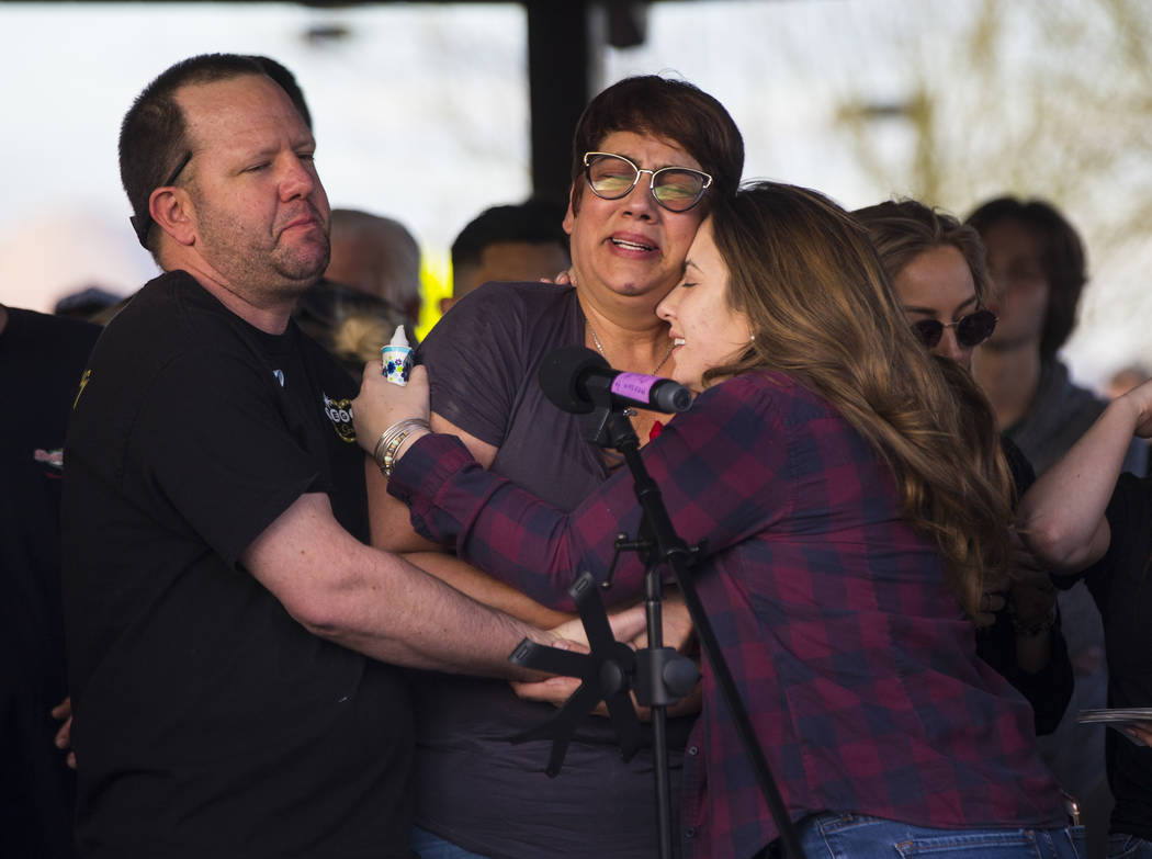 Allie Rossi, right, comforts Renee Mack, center, and Morgan Mack, parents of Dylan Mack, during a candlelight vigil at Knickerbocker Park in Las Vegas Friday, March 30, 2018. Dylan Mack, along wit ...