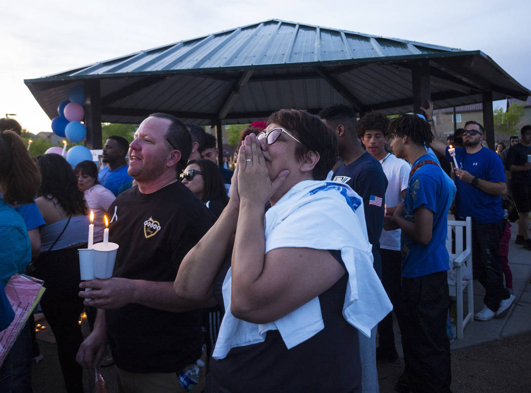 Morgan and Renee Mack, parents of Dylan Mack, watch a balloon get released in his memory during a candlelight vigil at Knickerbocker Park in Las Vegas Friday, March 30, 2018. Dylan Mack, along wit ...