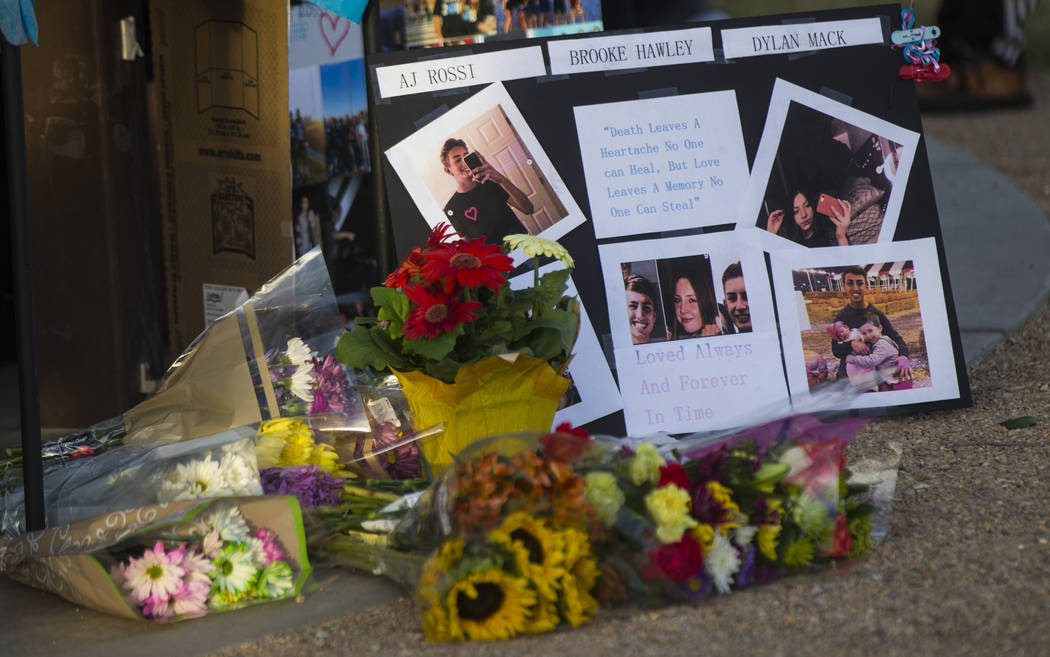 Items on display during a candlelight vigil at Knickerbocker Park in Las Vegas Friday, March 30, 2018 for Centennial High School students Albert ÒA.J.Ó Rossi, Dylan Mack and Brooke Hawle ...