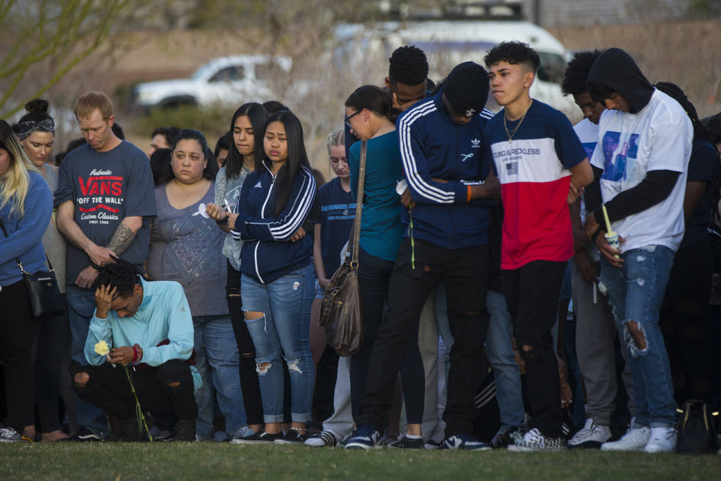 Attendees during a candlelight vigil at Knickerbocker Park in Las Vegas Friday, March 30, 2018 for Centennial High School students Albert ÒA.J.Ó Rossi, Dylan Mack and Brooke Hawley, who  ...