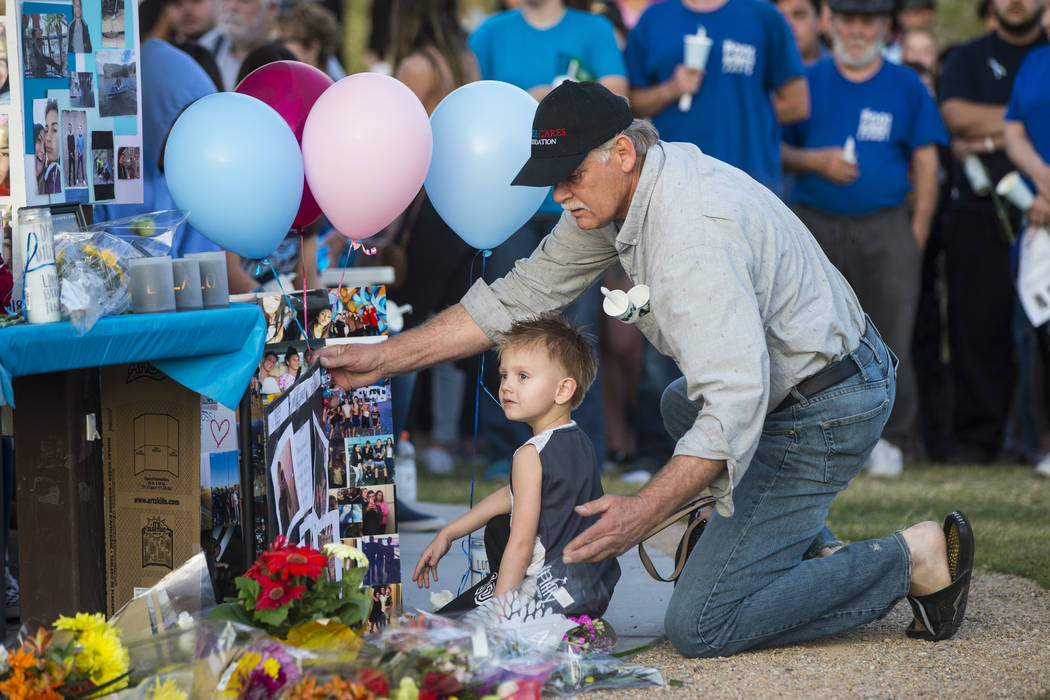 Attendees leave items behind during a candlelight vigil at Knickerbocker Park in Las Vegas Friday, March 30, 2018 for Centennial High School students Albert ÒA.J.Ó Rossi, Dylan Mack and  ...