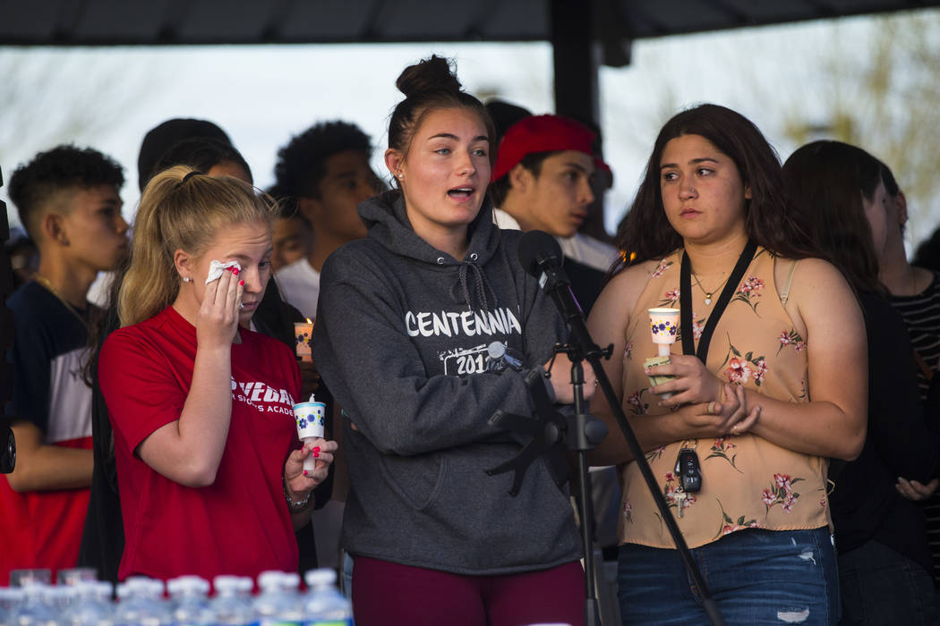 Addison Riddle, center, talks about the loss of her friend Brooke Hawley during a candlelight vigil at Knickerbocker Park in Las Vegas Friday, March 30, 2018. Brooke Hawley, along with fellow Cent ...