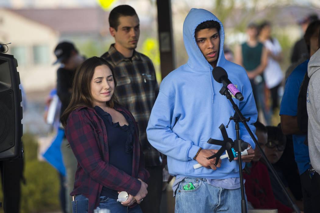 Tyler McAdams, right, speaks alongside Allie Rossi during a candlelight vigil at Knickerbocker Park in Las Vegas Friday, March 30, 2018 for Centennial High School students Albert ҁ.J.Ӡ ...