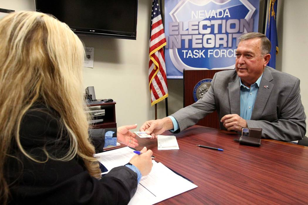 Former Nevada Rep. Cresent Hardy, right, files to run for his old Congressional District 4 seat with Irene Jimenez-Muir at the Secretary of State Las Vegas office Monday, March 5, 2018.  (K.M. Can ...