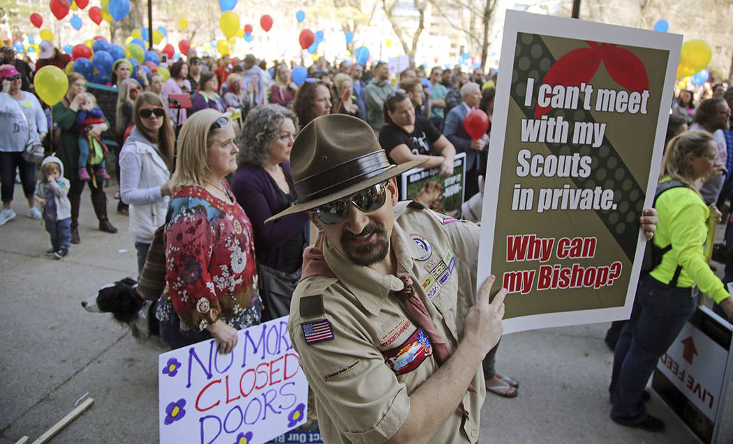 Jesse Stay, a former scout master, shows his support with about 1,000 Mormons and ex-Mormons before marching to the church's headquarters to deliver petitions demanding an end to one-on-one interv ...