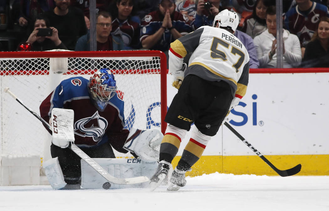 Colorado Avalanche goaltender Semyon Varlamov, left, stops the shot of Vegas Golden Knights left wing David Perron in the shootout session of an NHL hockey game Saturday, March 24, 2018, in Denver ...