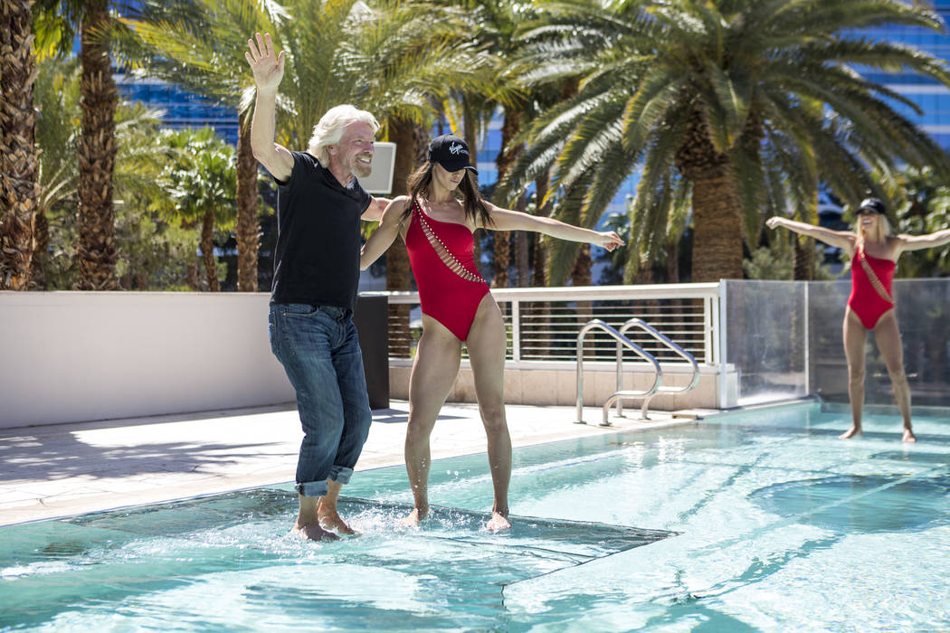 Virgin Group Founder Sir Richard Branson dances with Angela Krpicak of Gar Entertainment following a press conference at the Hard Rock Hotel in Las Vegas on Friday, March 30, 2018.  Patrick Connol ...
