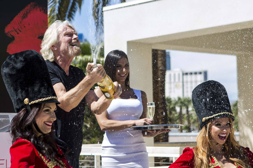 Virgin Group Founder Sir Richard Branson pops a champagne bottle following a press conference at the Hard Rock Hotel in Las Vegas on Friday, March 30, 2018.  Patrick Connolly Las Vegas Review-Jour ...