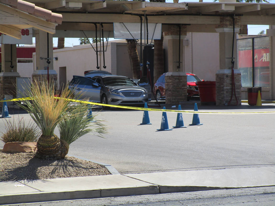 Cars remain at Terrible's Car Wash & Lube after police blocked off access to the business as they investigated a shooting at the Henderson business at Annie Oakley Drive and Sunset Road on Fri ...