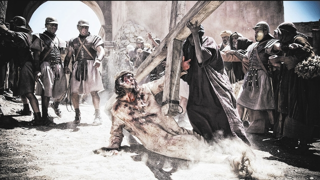 Jesus (Diogo Morgado) stumbles on his way to the crucifixion. Photo: Casey Crafford - © 2013 LightWorkers Media Inc and Hearst Productions Inc. All rights reserved. Not for sale or duplication.