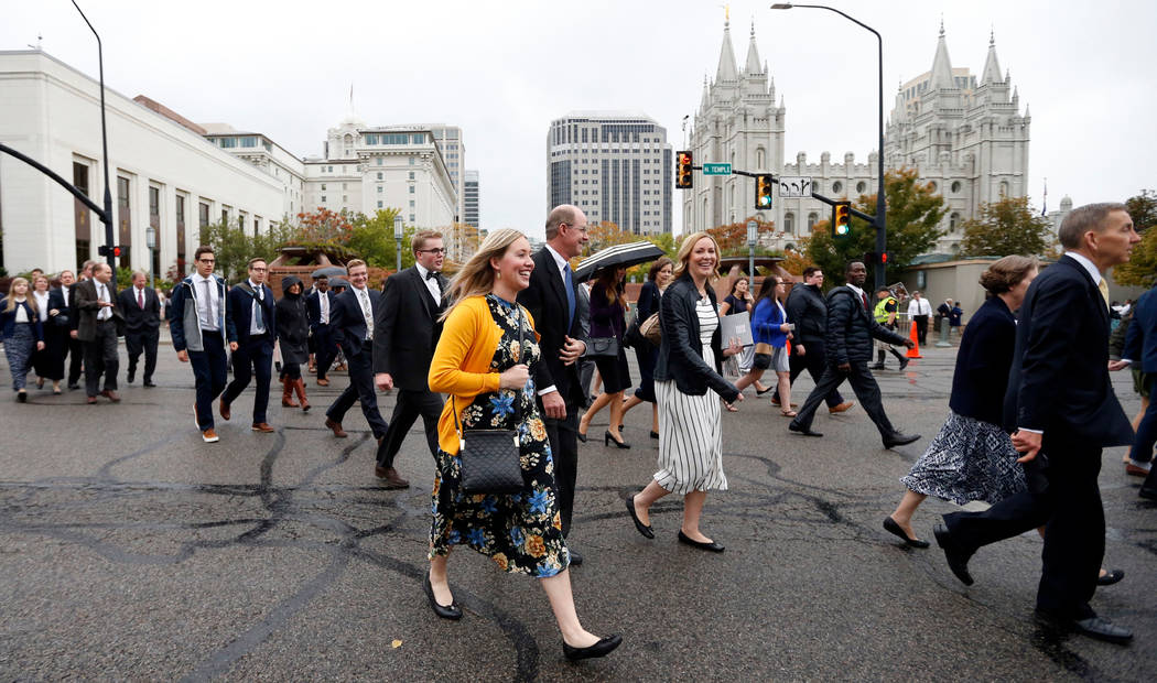 People arrive for the morning session of the two-day Mormon church conference in Salt Lake City on Sept. 30, 2017. (AP Photo/Rick Bowmer, File )